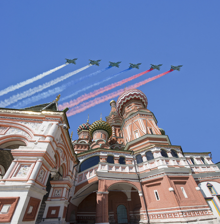 Russian military aircrafts fly in formation over Moscow(Saint Basil cathedral) during Victory Day parade, Russia