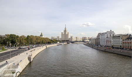 View of Moskva river and Kotelnicheskaya Embankment Building from new floating bridge in Zaryadye park, Moscow, Russia.