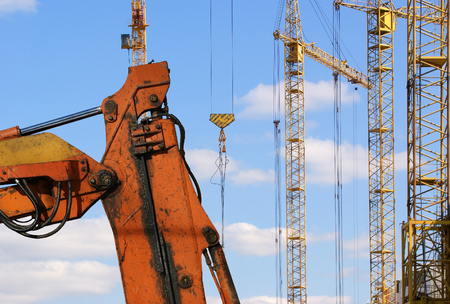 Construction machinery, high and heavy construction machinery  on the sky with clouds Stock Photo