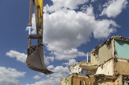 Demolition of an old house on the sky with clouds. Moscow, Russia