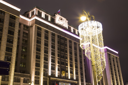 Christmas (New Year) holidays illumination and Building of The State Duma of the Federal Assembly of Russian Federation at night, Moscow, Russia    Stock Photo