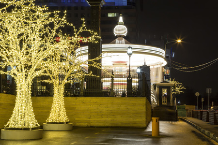 Carousel and Christmas (New Year holidays) decoration in Moscow (at night), Russia