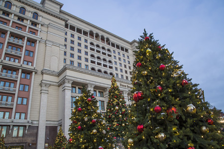 Christmas and New Year holidays illumination and Four Seasons Hotel Moscow at night. Russia