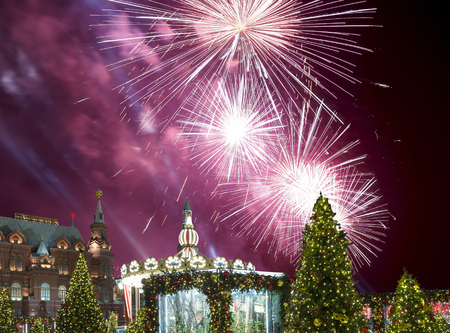 Fireworks over the Christmas and New Year holidays illumination at night, Kremlin in Moscow, Russia. Historical Museum -- inscription in Russian Éditoriale