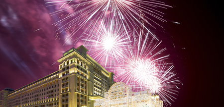 Fireworks over the Christmas and New Year holidays illumination and Four Seasons Hotel at night. Moscow. Russia   Éditoriale