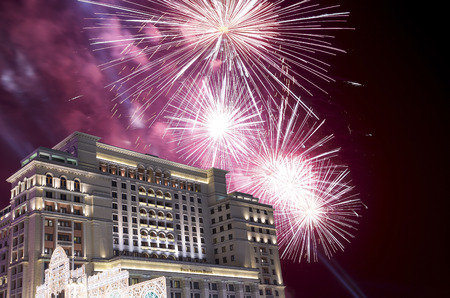 Fireworks over the Christmas and New Year holidays illumination and Four Seasons Hotel at night. Moscow. Russia   Banque d'images