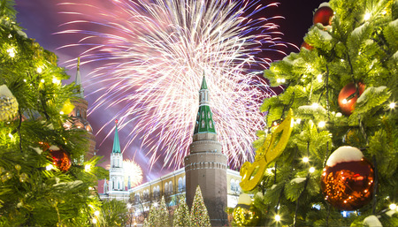 Fireworks over the Christmas and New Year holidays illumination at night, Kremlin in Moscow, Russia.