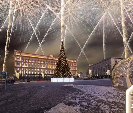 Fireworks over the Christmas (New Year holidays) decoration Lubyanskaya (Lubyanka) Square in the evening, Moscow, Russia   Éditoriale
