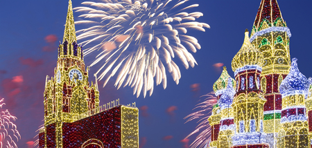 Fireworks over the Christmas (New Year holidays) decoration in Moscow (at night), Russia