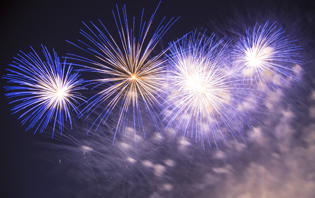 Celebratory colorful fireworks exploding in the skies. Stock Photo