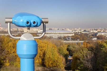Touristic telescope viewer (binoculars) and view of central Moscow from Sparrow Hills or Vorobyovy Gory observation (viewing) platform-- is on a steep bank 85 m above the Moskva river, or 200 m above sea level. Moscow, Russia Publikacyjne