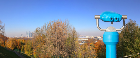 Touristic telescope viewer (binoculars) and Panoramic view of Sparrow Hills or Vorobyovy Gory observation (viewing) platform-- is on a steep bank 85 m above the Moskva river, or 200 m above sea level. Moscow, Russia