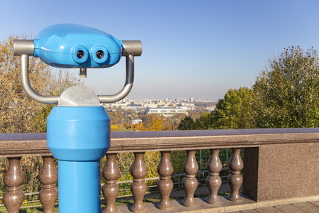 Touristic telescope viewer (binoculars) and view of central Moscow from Sparrow Hills or Vorobyovy Gory observation (viewing) platform-- is on a steep bank 85 m above the Moskva river, or 200 m above sea level. Moscow, Russia Zdjęcie Seryjne