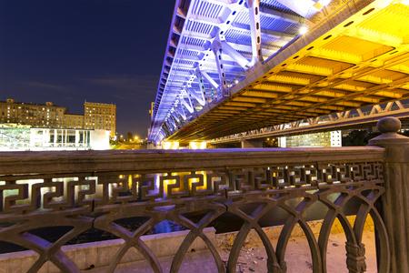 Evening view of the Dorogomilovsky bridge across the Moskva river, Moskow, Russia