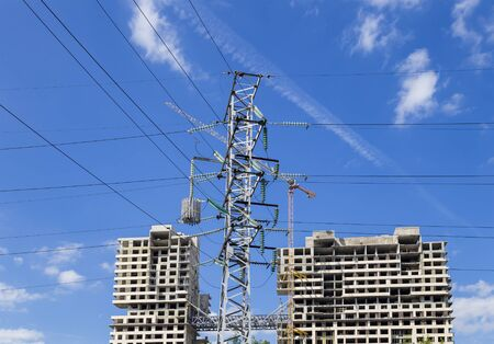 Electricity pylons and construction site, Industrial image. Moscow, Russia Imagens