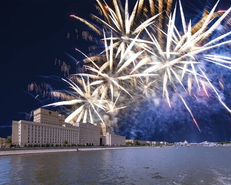 Main Building of the Ministry of Defence of the Russian Federation-- is the governing body of the Russian Armed Forces and celebratory colorful fireworks exploding in the skies. Moscow, Russia 写真素材