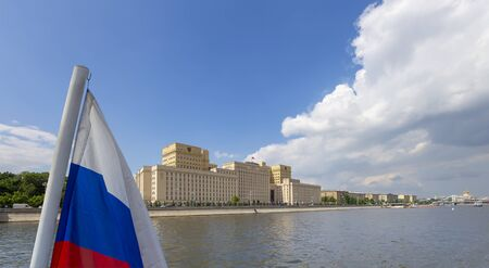 Russia flag and Main Building of the Ministry of Defence of the Russian Federation -- is the governing body of the Russian Armed Forces. Moscow, Russia