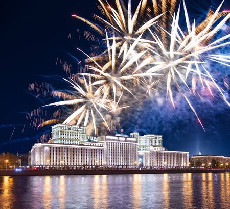 Main Building of the Ministry of Defence of the Russian Federation-- is the governing body of the Russian Armed Forces and celebratory colorful fireworks exploding in the skies. Moscow, Russia Archivio Fotografico