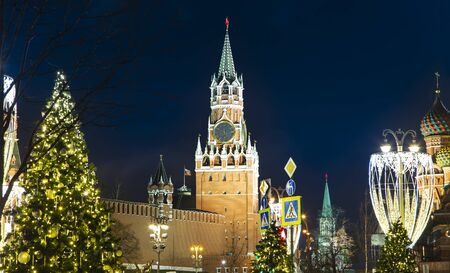 Christmas (New Year holidays) decoration in Moscow (at night), Russia-- The Spasskaya Tower. Journey to Christmas, Moscow seasons. View from Zaryadye Park