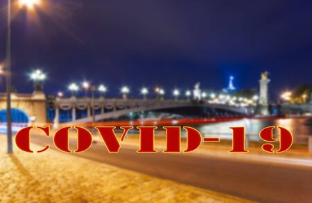 Coronavirus in Paris, France. Covid-19 sign. Concept of COVID pandemic and travel in Europe. The Alexander III bridge at night Foto de archivo