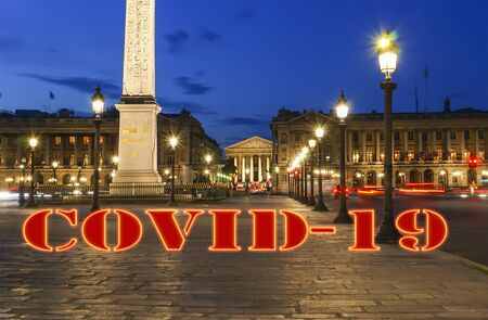 Coronavirus in Paris, France. Covid-19 sign. Concept of COVID pandemic and travel in Europe. Place de la Concorde and  Obelisk of Luxor at night