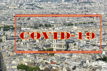 Coronavirus in Paris, France. Covid-19 sign. Concept of COVID pandemic and travel in Europe. The city skyline at daytime. Stock Photo