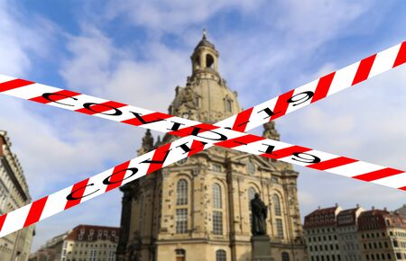 Coronavirus in Dresden, Germany. Frauenkirche ( literally Church of Our Lady). Covid-19 sign on a blurred background. Concept of COVID pandemic and travel in Europe. Stock Photo