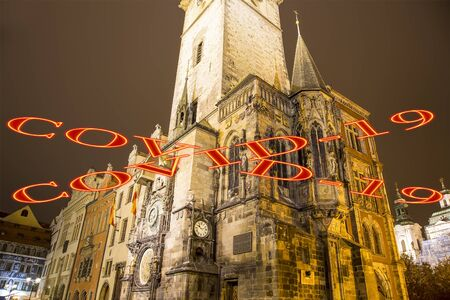 Coronavirus in Prague, Czech Republic. Old Town City Hall. Covid-19 sign. Concept of COVID pandemic and travel in Europe. Reklamní fotografie