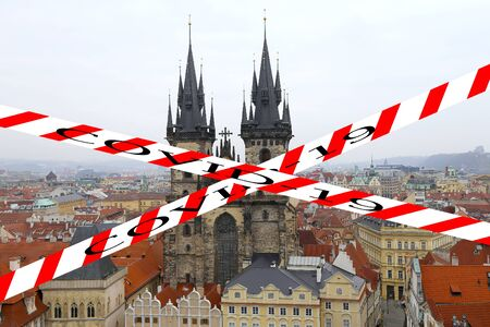 Coronavirus in Prague, Czech Republic. The gothic Church of Mother of God in front of Tyn in Old Town Square. Covid-19 sign. Concept of COVID pandemic and travel in Europe.