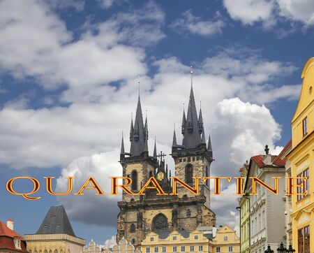 Coronavirus in Prague, Czech Republic. The gothic Church of Mother of God in front of Tyn. Quarantine sign. Concept of COVID pandemic and travel in Europe.