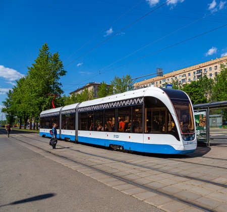Modern tram (urban electric transport) on a Moscow street (central district), Russia Редакционное