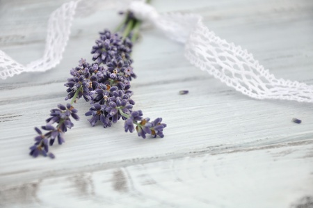 Lavender bouquet with lace on white wood photo
