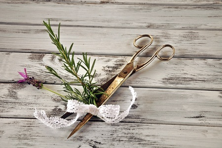 cut flowers: Rosemary branch and lavender caught in the scissors with lace loop