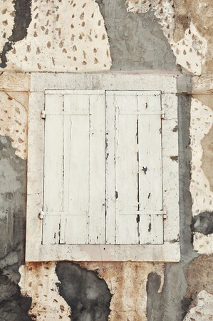 White closed old wooden shutter in mediterranean style photo