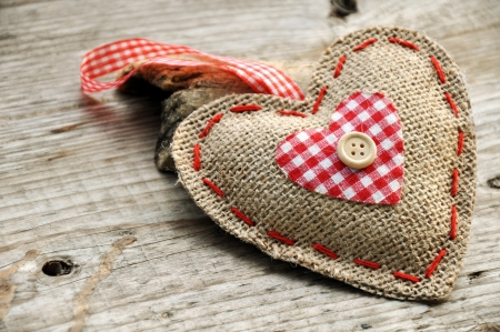 Heart from jute with button on wooden basis photo