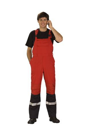 overall: Man in overall with mobile Stock Photo