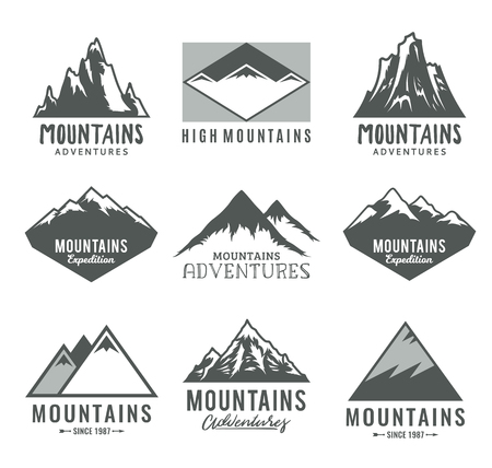 Vector mountains logo isolated on white. Mountains, rocks and peaks icons. 向量圖像