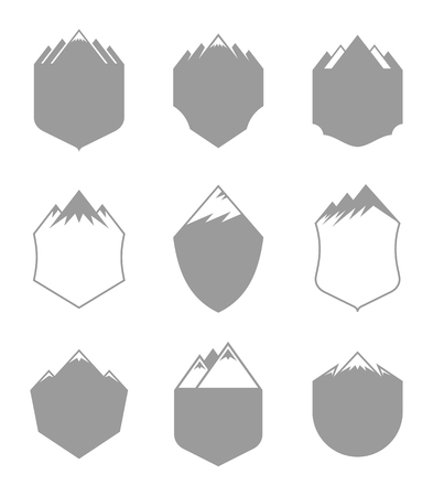 Vector mountains blank badges isolated on white. Tourism and travel labels.