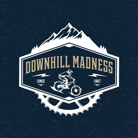 Vector downhill mountain biking badge, label with rider on a bike and mountain silhouette. Downhill, enduro, cross-country biking illustration Banco de Imagens - 138425468