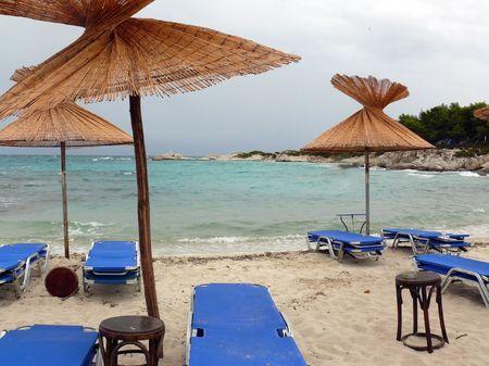 Deck chairs on a mediterranean beach Stock Photo