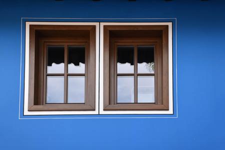 Windows on a blue facade of a Bulgarian traditional house