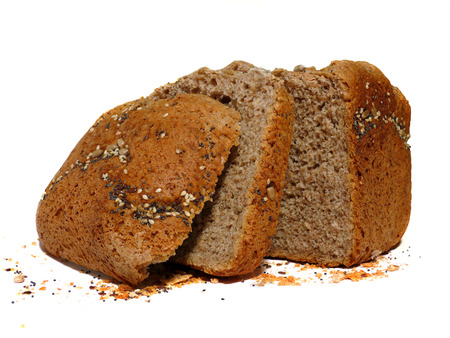 Wholemeal bread with seeds, cut in slices Stock Photo