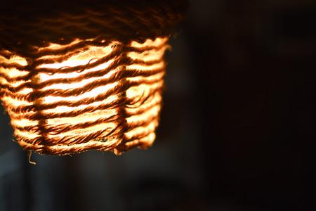 Organic rope lantern glowing in the dark
