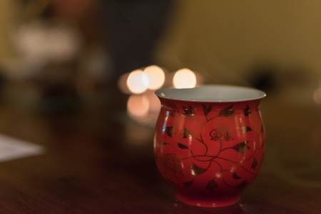 Closeup of a red decorated porcelain cup for Chinese tea