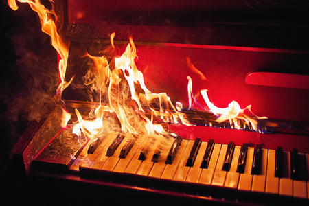 Piano on fire Stock Photo
