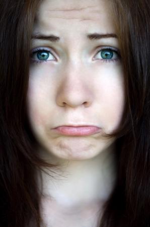 Portrait of beautiful upset girl looking at camera Stock Photo - 20778571