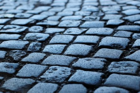 traditional and historic blue cobblestone way blured photo