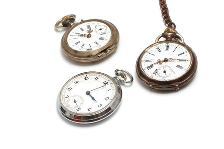 Three old broken pocket watch isolated on white photo