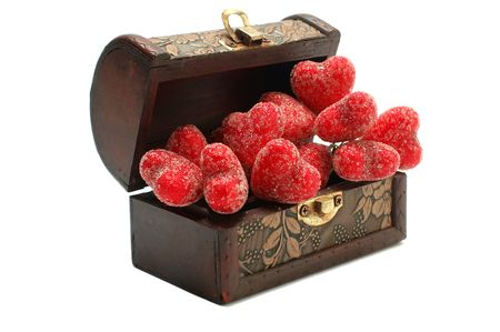 Beautiful red hearts in the old gold brown box photo