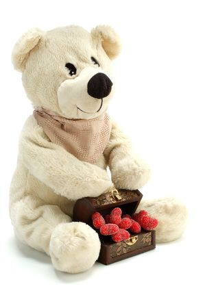 curio: Teddy bear with hearts isolated on white Stock Photo